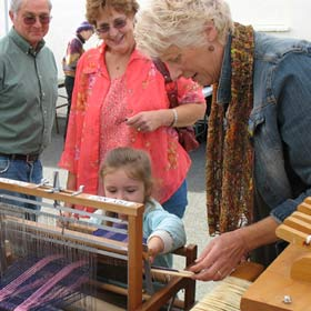 Little Girl Weaving at Fiber Arts Festival
