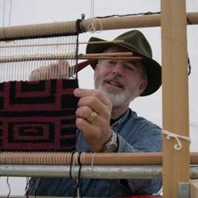 Len weaving a rug