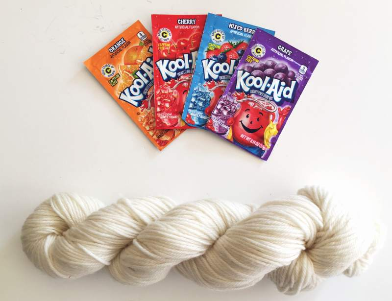 Wool yarn and Kool Aid drink packets