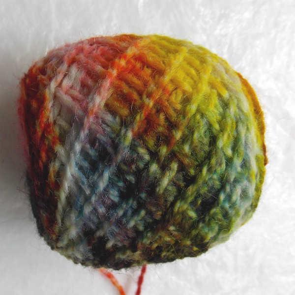 unwinding the dyed yarn