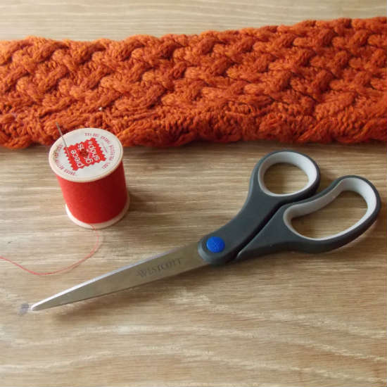 Supplies needed to make fingerless gloves from the sleeve of a sweater