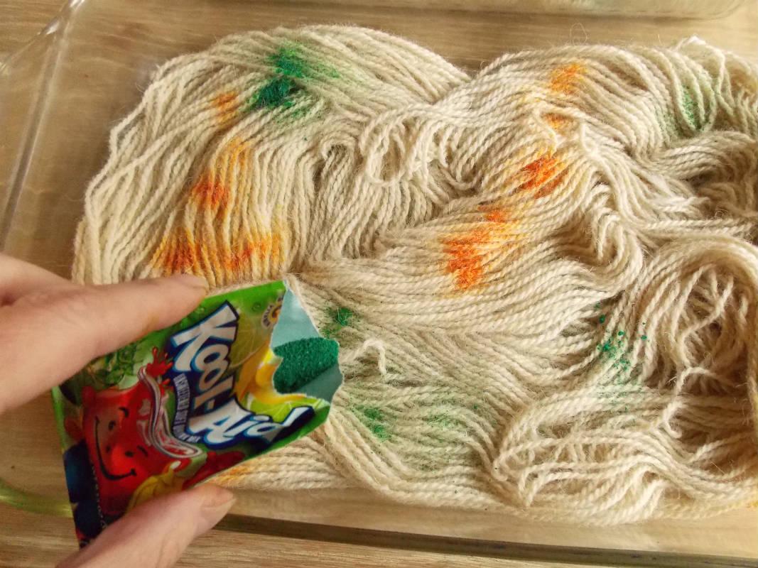 Add more Kool Aid powder dye to the yarn