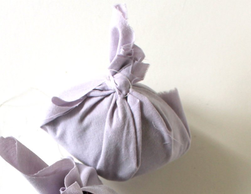 Dying eggs with silk ties. Wrap the bundle with scrap fabric