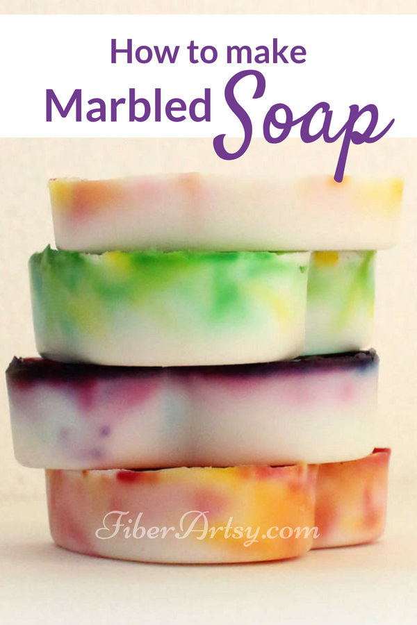 Fun and easy way to make some pretty (and pretty smelling) marbled goat milk soap. Homemade beauty recipe which also is a great DIY Gift Idea for Christmas, Birthdays or Valentines Day. You can find lots of other beauty recipes including bath salts, scrubs and lotion bars. A FiberArtsy.com free craft tutorial
