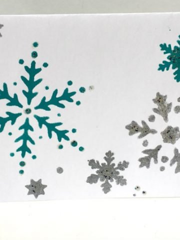 Card Stock Paper stenciled with Snow Flakes for a Handmade Christmas Card