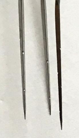 Close up of notches on felting needles