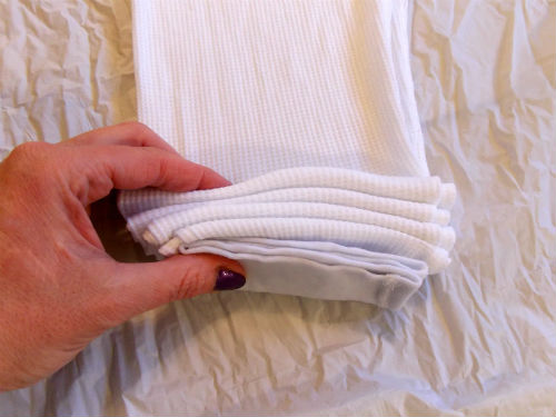 Folding the long johns with the accordion fold method