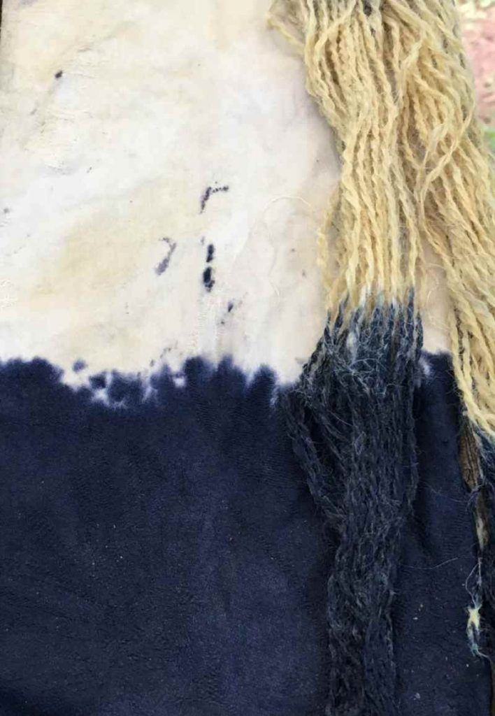 Cotton fabric and wool yarn dyed naturally with Blackberry Leaves and an Iron Modifier