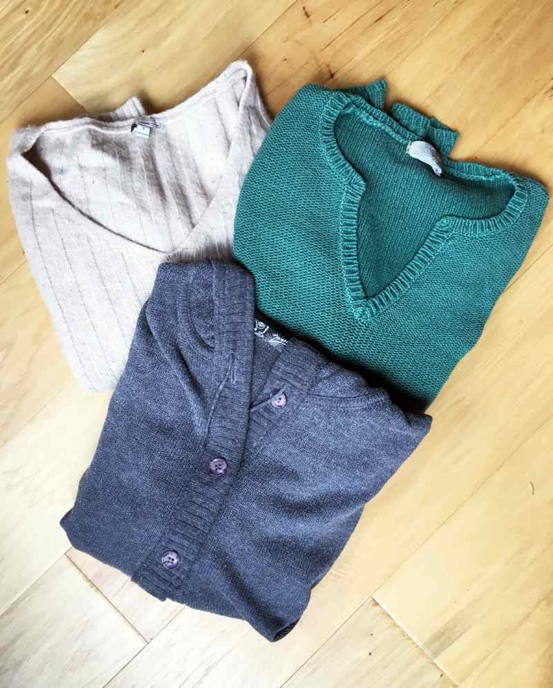 Various old sweaters for sewing into a sweater stocking