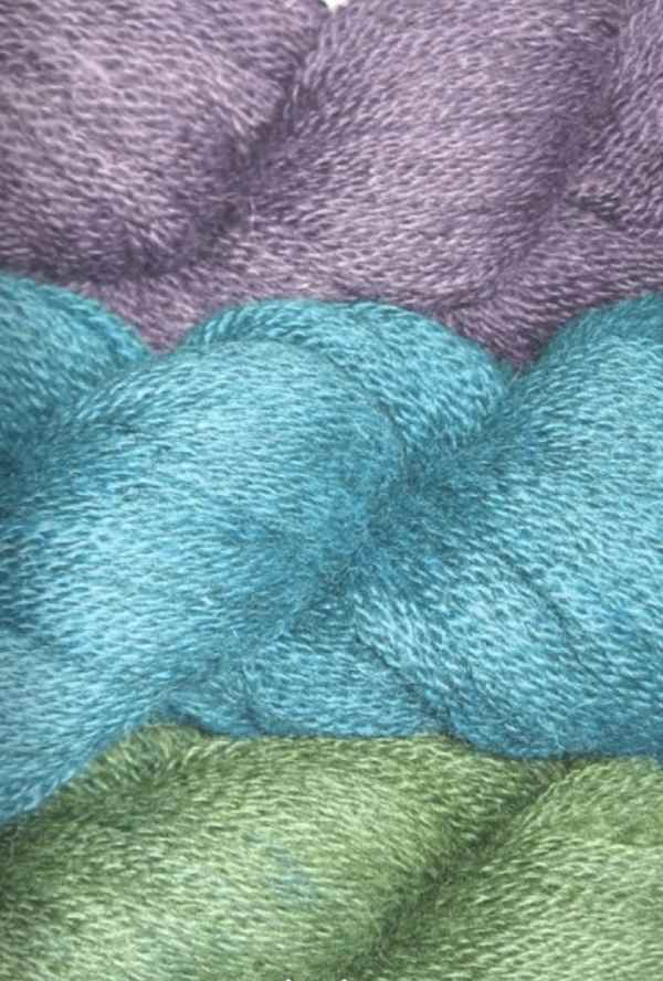 Grey alpaca yarn dyed with acid wool dyes to produce jewel tones
