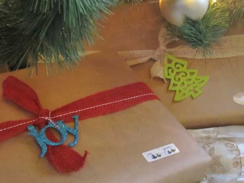 Brown paper gift wrap with ribbon and ornament tags