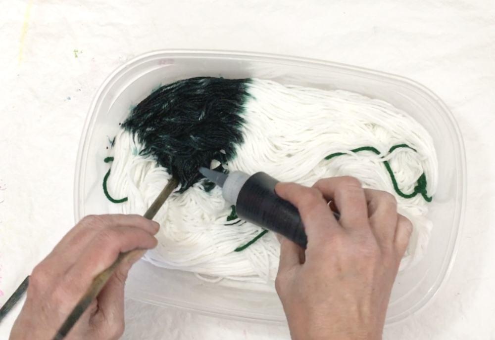 Continue applying dye to yarn