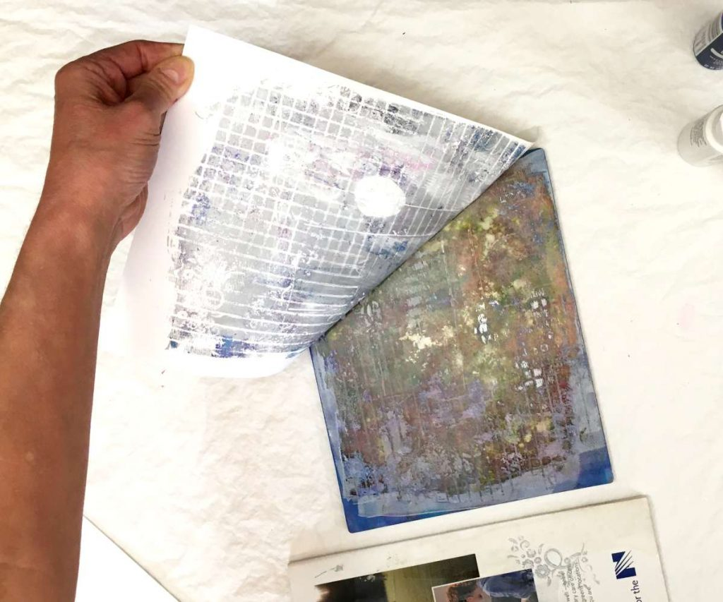 peeling the paper off the gel plate