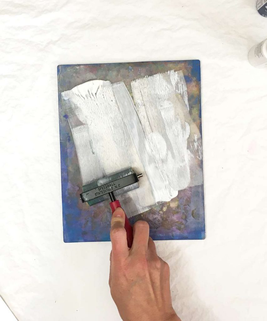 Use rubber brayer to distribute paint