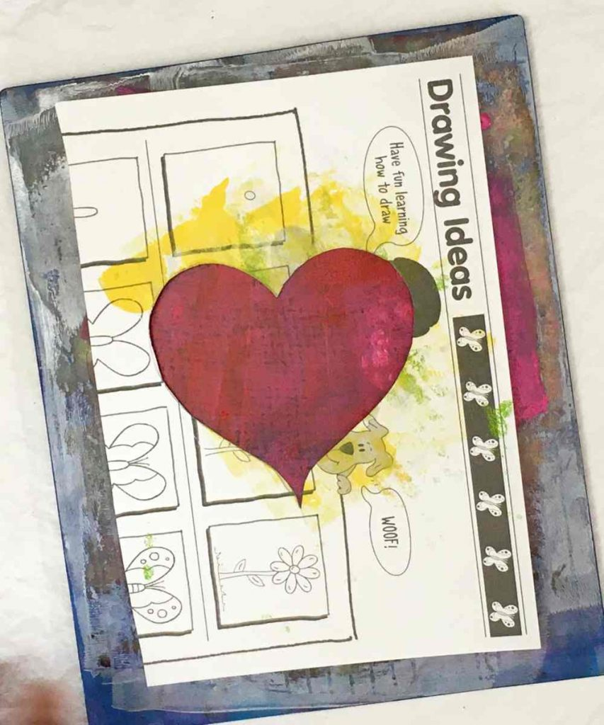 Use a stencil to make a heart shape on the card