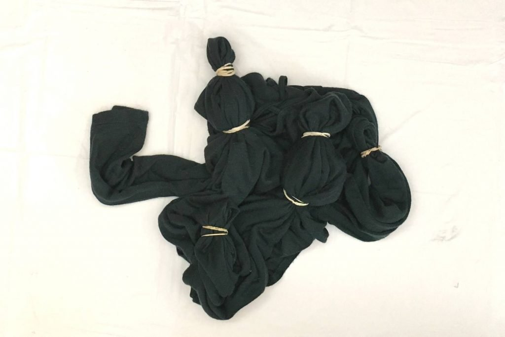 dark green shirt tied with rubber bands to create bullseyes