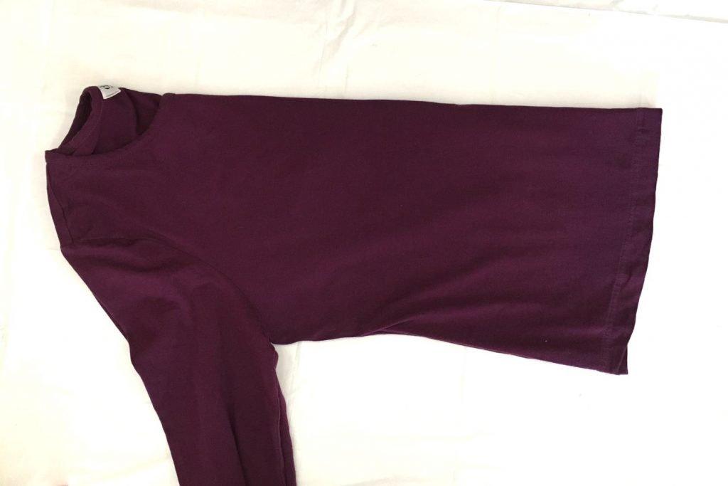 Fold shirt in half