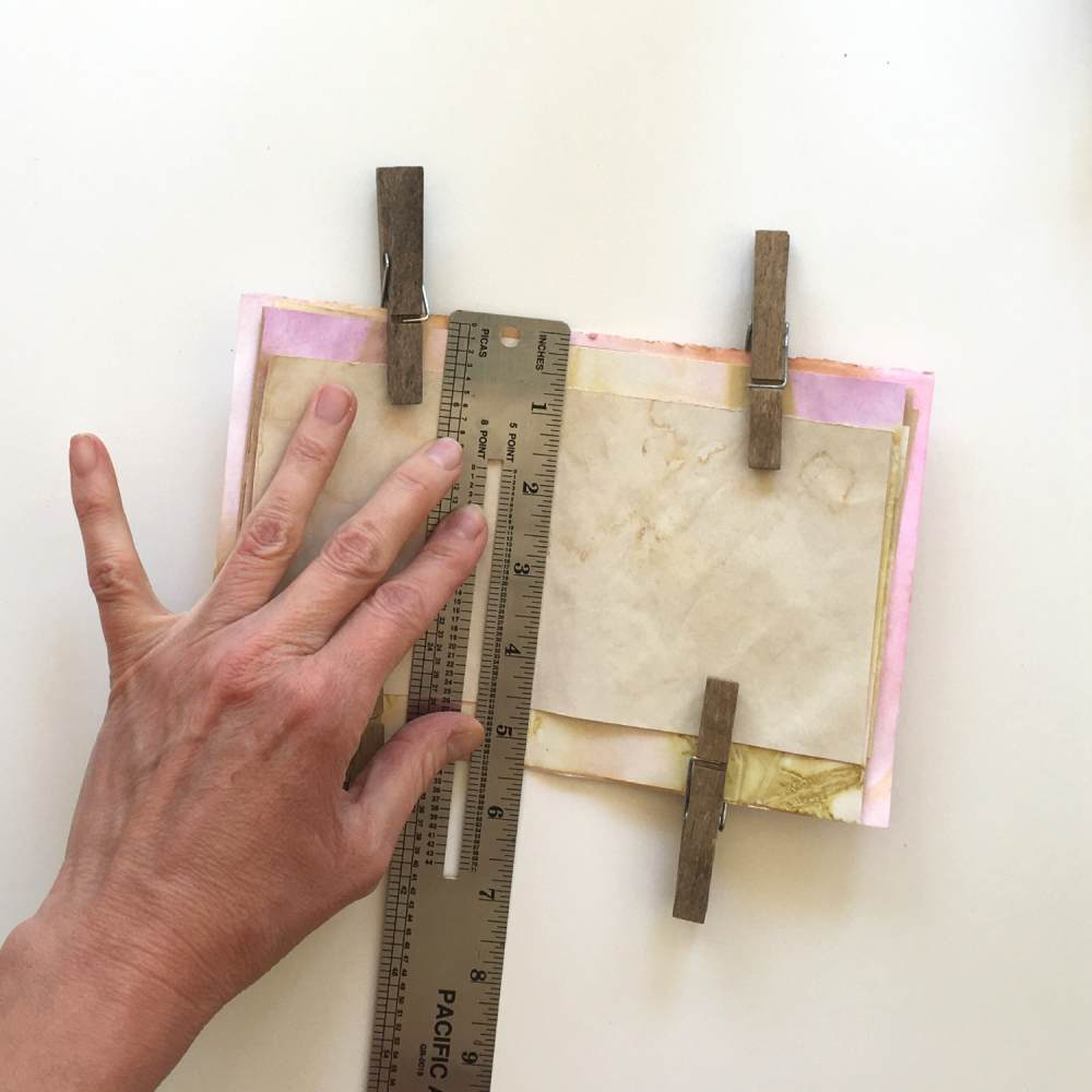 Use a ruler to measure where to put the holes for binding