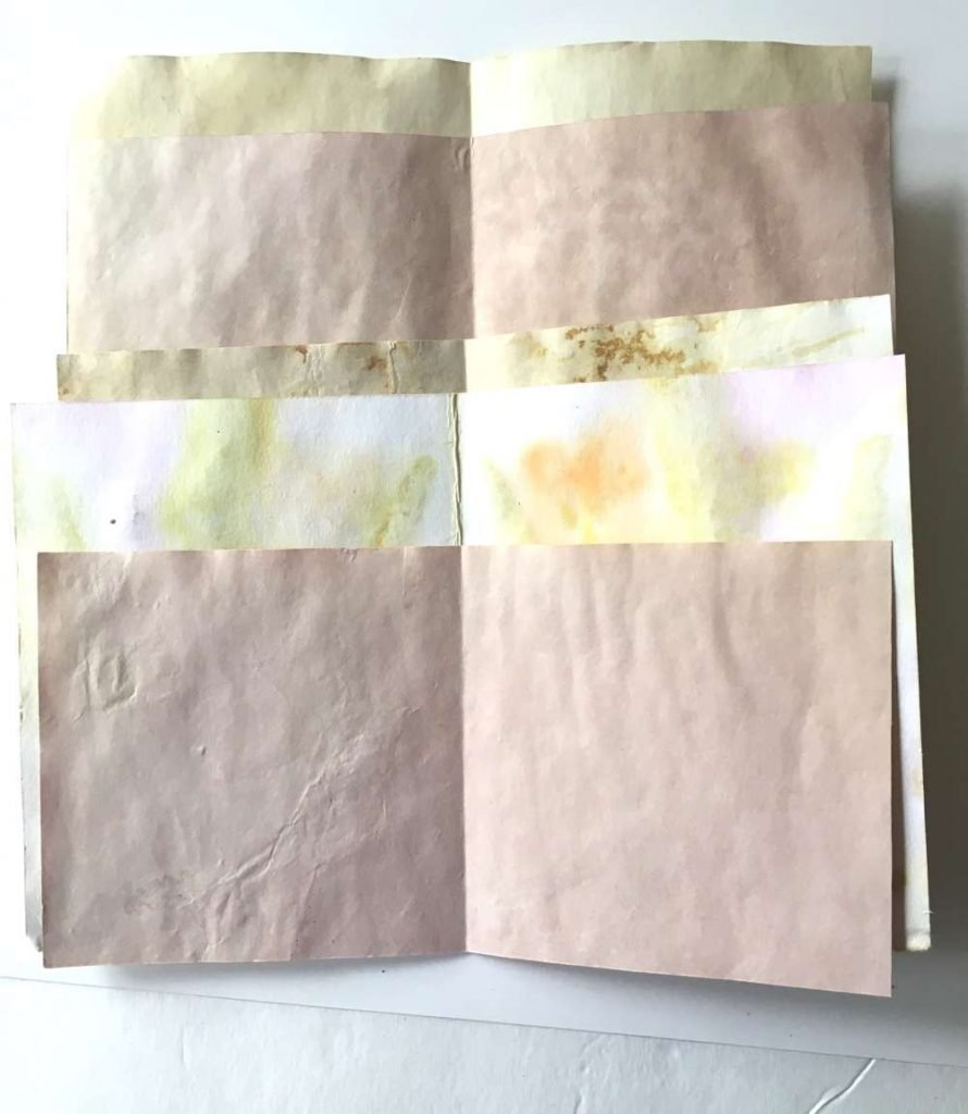 Papers cut for making a diy journal