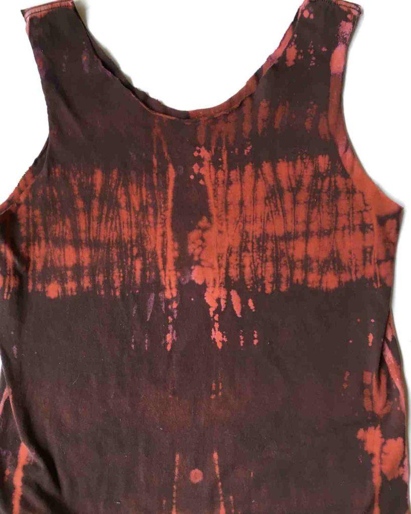 Pole wrap dye pattern on a brown shirt