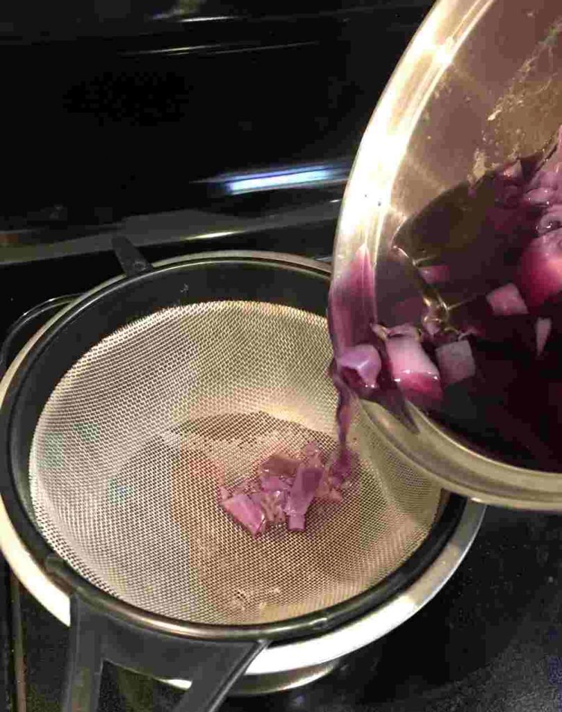 Straining the dye from the cabbage