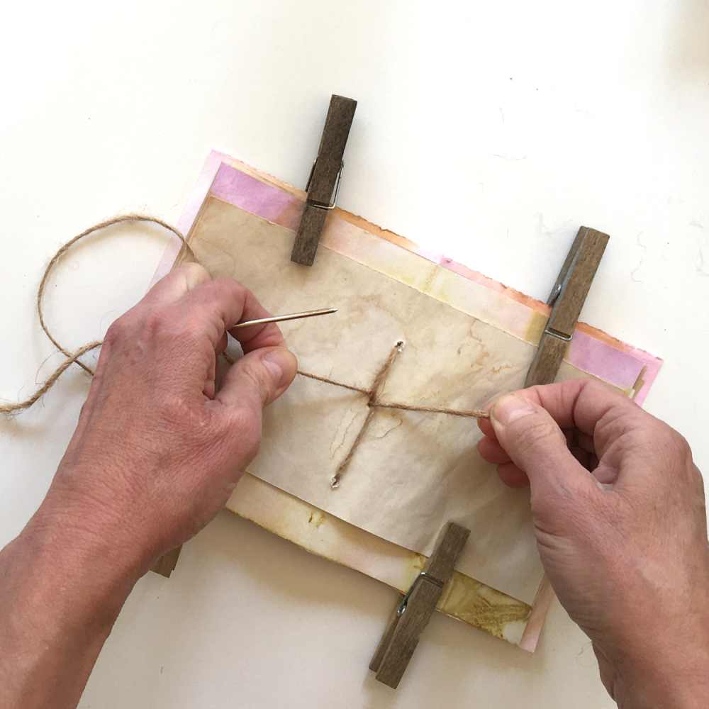 Tying a bow in the center of the journal