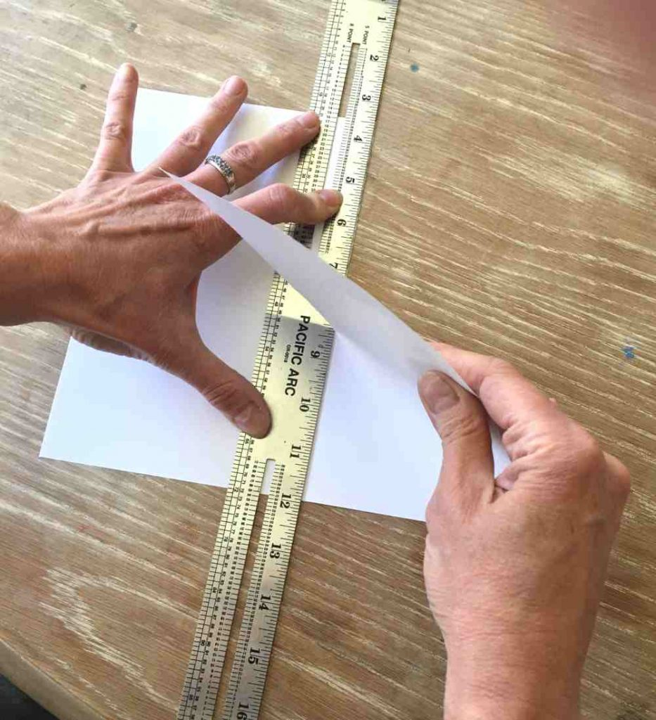 Tearing paper with a ruler