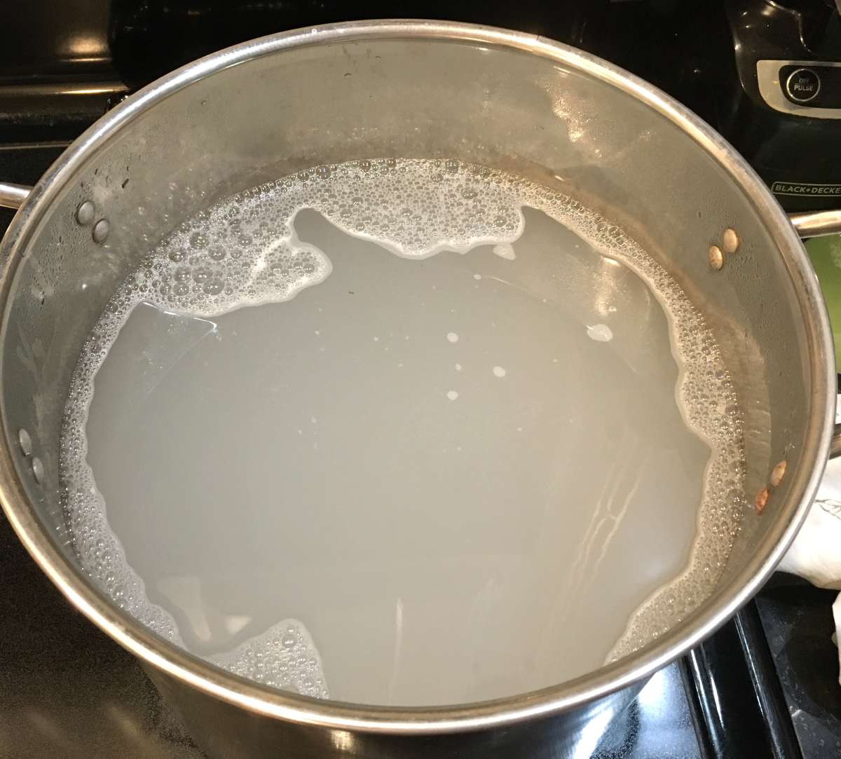 Mix water and washing soda to scour fabric