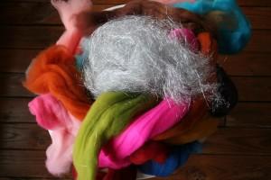 Liz Stottlemeyer of Hobbledehoy Yarn + Fibers about to make carding magic!