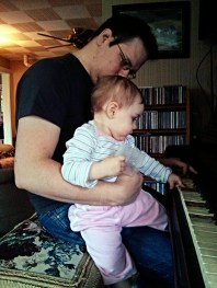 She loves playing piano with Daddy.