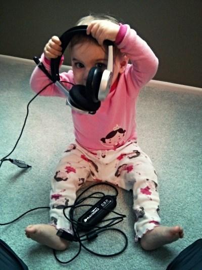 Wearing Mom's headphones.