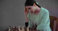 pensive ethnic woman thinking on chess move