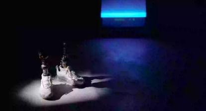 photo of white sneakers on spotlight