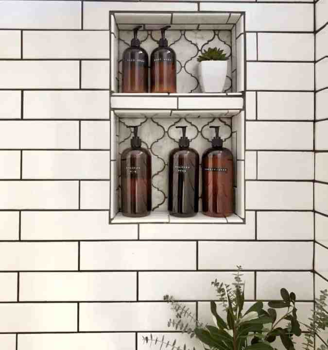 shower niche with amber bottles