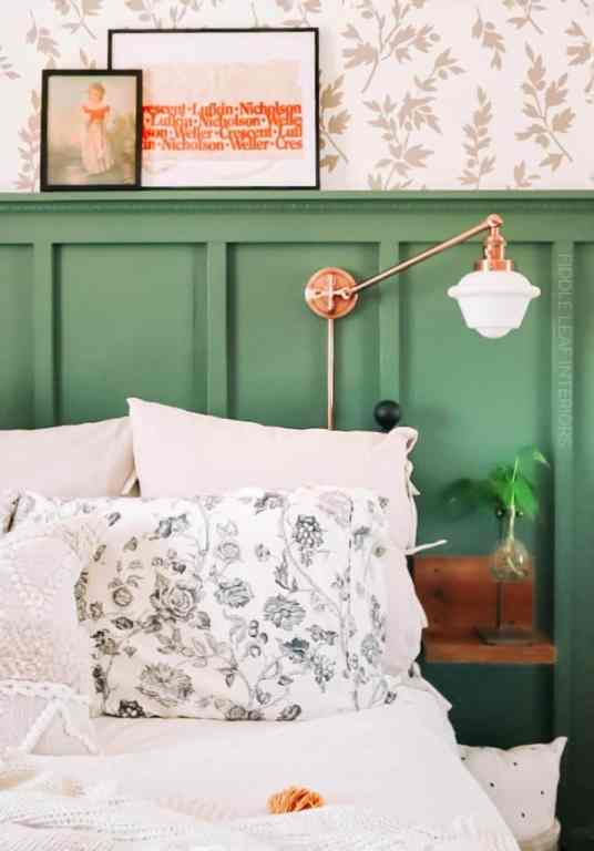 cozy cottage bedroom with floating nightstands and copper wall sconces