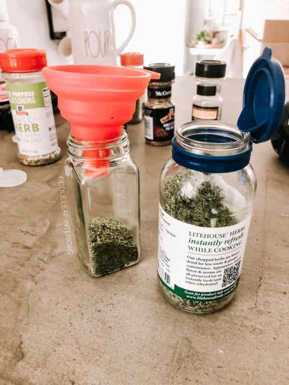 DIY spice drawer - filling jars with spices using small silicone funnel