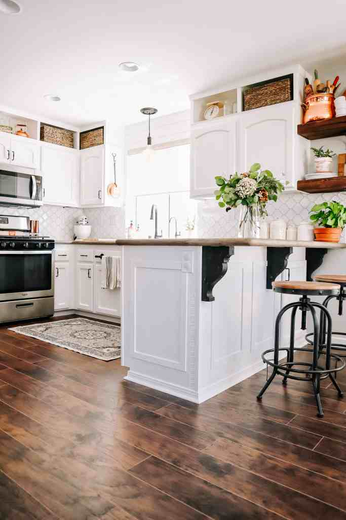 laminate flooring in white farmhouse kitchen