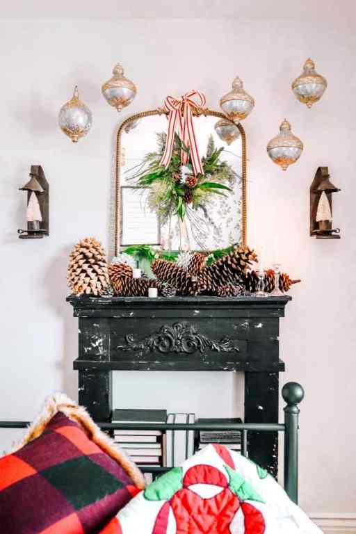 vintage christmas decorations and hanging ornaments over fireplace