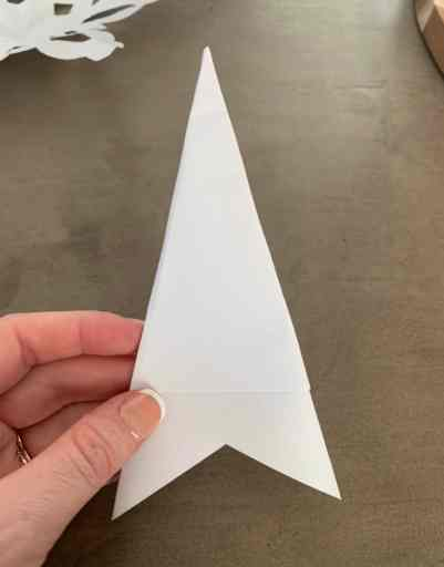 folding a snowflake out of paper