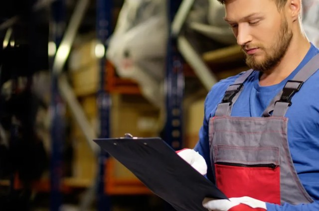 man holding clipboard for shipping