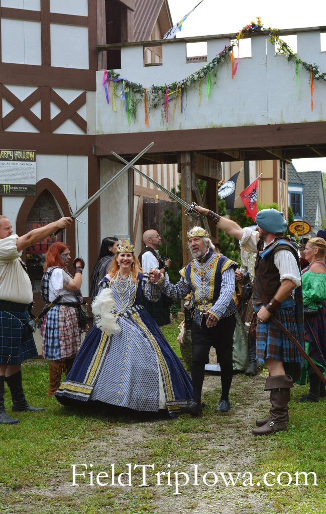 Family Guide to Renaissance Faire at Sleepy Hollow King and Queen walk through gate