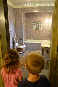 Salisbury House & Gardens Children look into Edith's bathroom