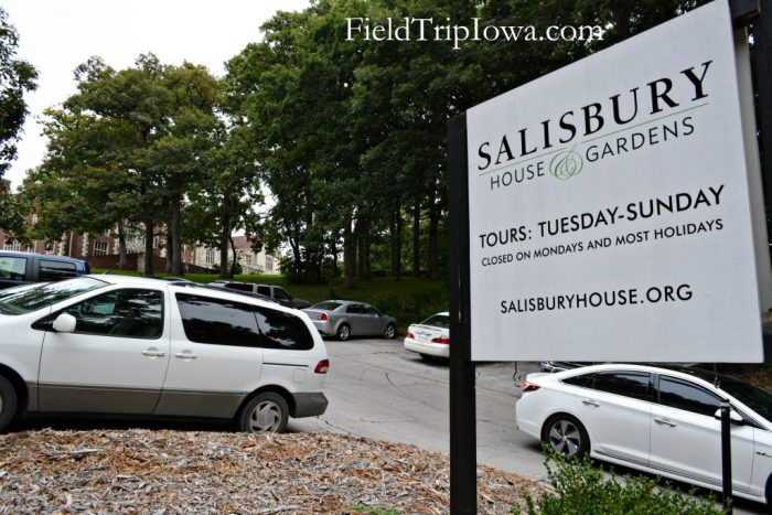 Salisbury House & Gardens parking lot on a slope and sign with hours