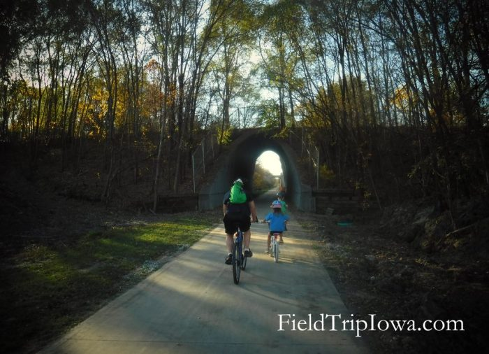 bikers riding into tunnel on High Trestle Trail Bridge Trail