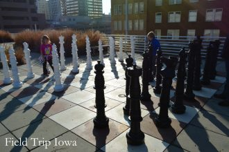 Kids playing life size chess on the roof of Kansas City Public Library