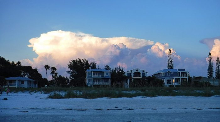 Houses along Bean Point beach at sunset on Anna Maria Island Florida.