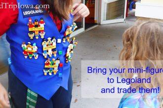 Staff member wearing Lego Mini figures to trade at Legoland theme park Florida.