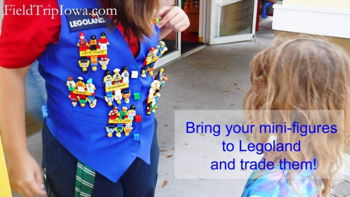 Staff member wearing Lego Mini figures to trade at Legoland theme park Florida.