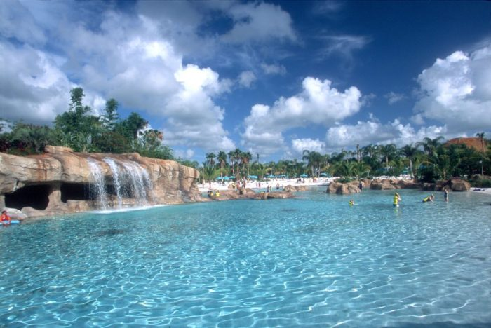 Swimming pool with amazing fun waterfall and landscape. Read more of our Family Review of Discovery Cove Florida