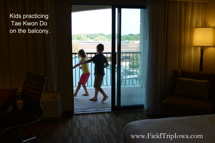 Kids enjoying balcony at hotel room at Courtyard By Marriott in Roseville MN